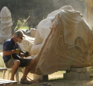 Artist Antone Bruinsma working sculpture